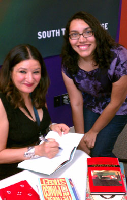 Photo: Sandra Cisneros and me at book signing