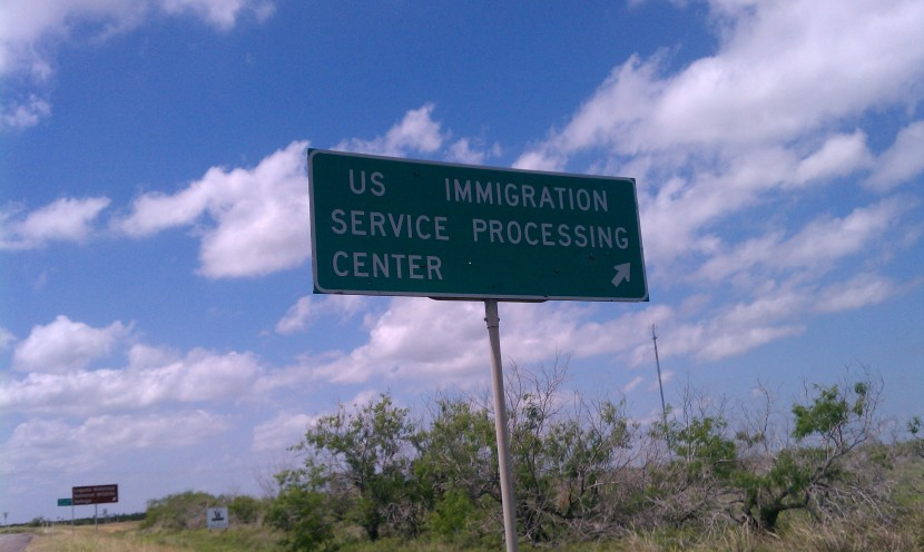 "Photo of sign saying ""US IMMIGRATION SERVICE PROCESSING CENTER"""