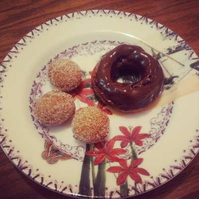 Doughnut with chocolate glaze and three doughnut holes