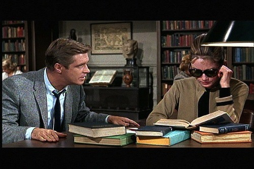Audrey Hepburn reading in library (scene from Breakfast at Tiffanys)